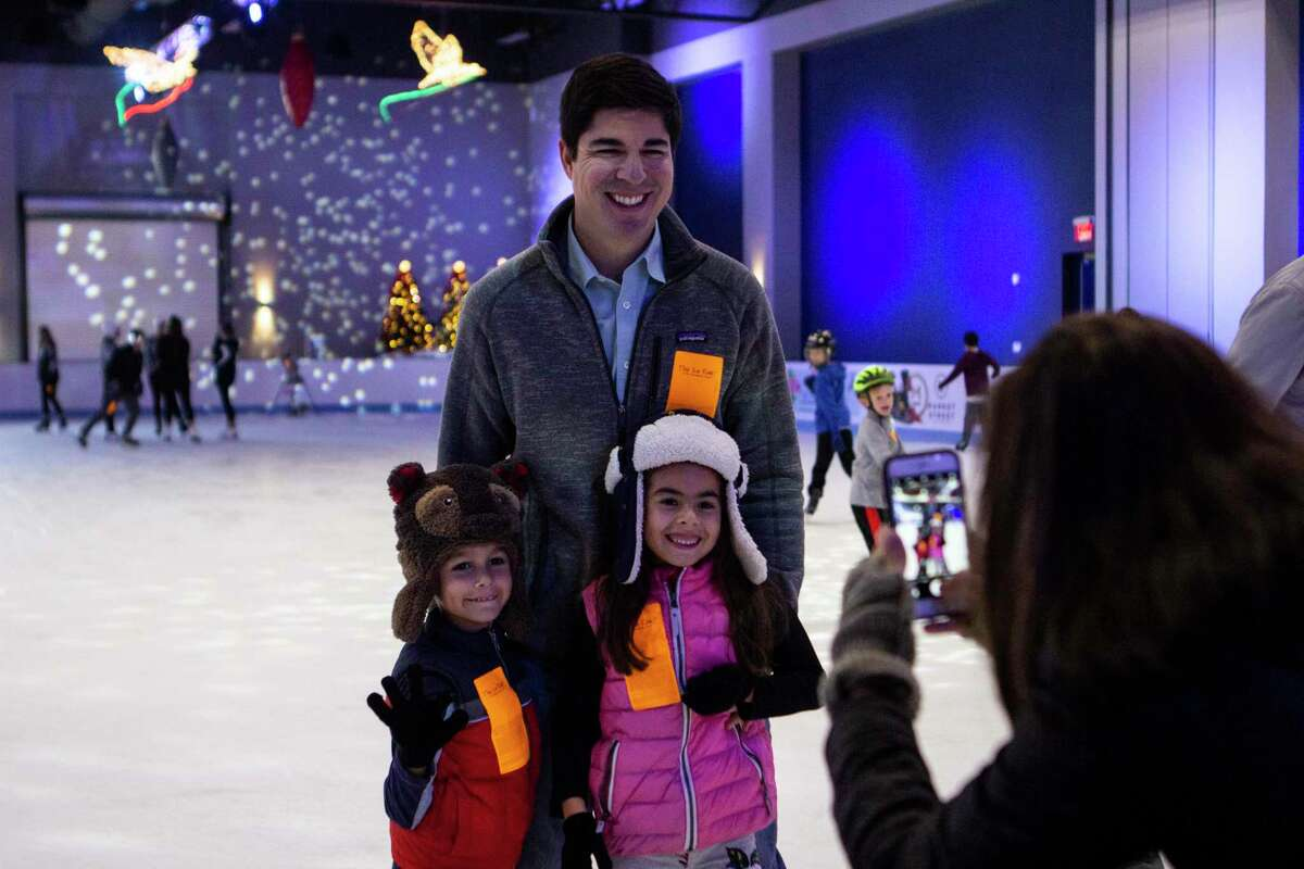Angel Nicks, assistant director for Parks and Recreation at The Woodlands Township,told The Villagerin October what residents can expect during the 2020-21 Ice Rink season, which has new changes to the icy fun due to COVID-19. Reservations are required via an online portal at the township's special ice rink website. In this 2018 archive photograph, Steve Romero of The Woodlands pauses skating with his children Bruno Romero and Roxana Romero to have a photo taken by Melanie Romero at The Ice Rink.