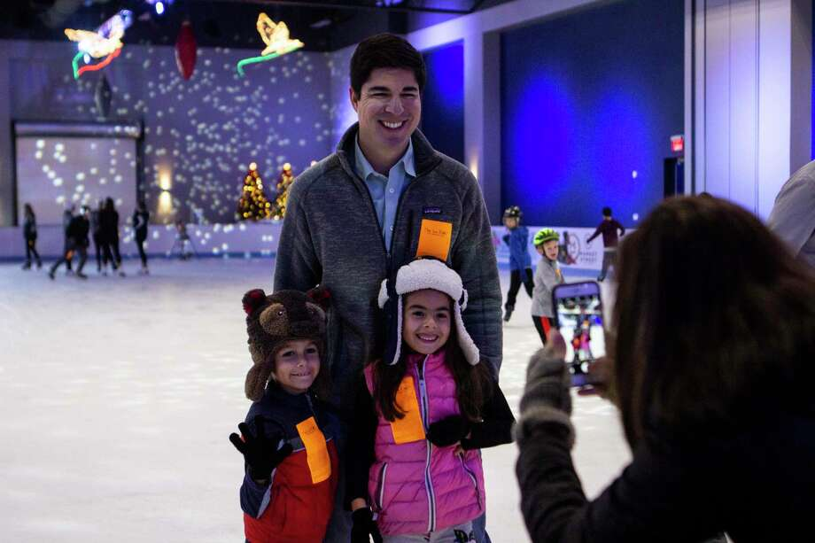 The Woodlands resident Steve Romero pauses skating with his children Bruno Romero and Roxana Romero to have a photo taken by Melanie Romero at The Ice Rink at The Woodlands Town Center on opening day Saturday, Nov. 17, 2018 in The Woodlands. Photo: Cody Bahn, Houston Chronicle / Staff Photographer / © 2018 Houston Chronicle