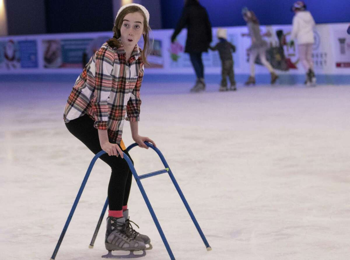The Woodlands resident Addy Tague skates by using a walker at The Ice Rink at The Woodlands Town Center on opening day Saturday, Nov. 17, 2018 in The Woodlands.>>>Keep clicking for the best spots to see holiday lights in Houston...