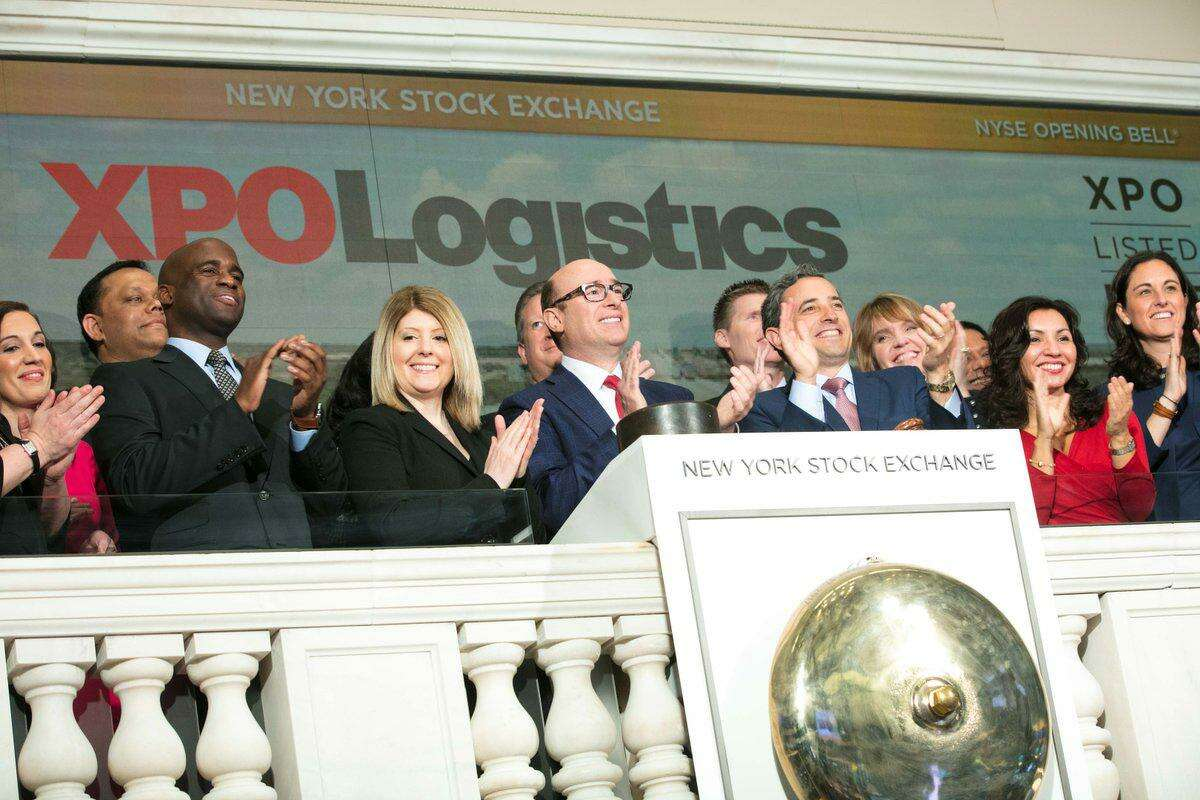 XPO Logistics CEO Bradley Jacobs, center, marks in April 2018 the opening of the New York Stock Exchange with fellow executives of the Greenwich, Conn.-based trucking giant. (XPO photo via Twitter)