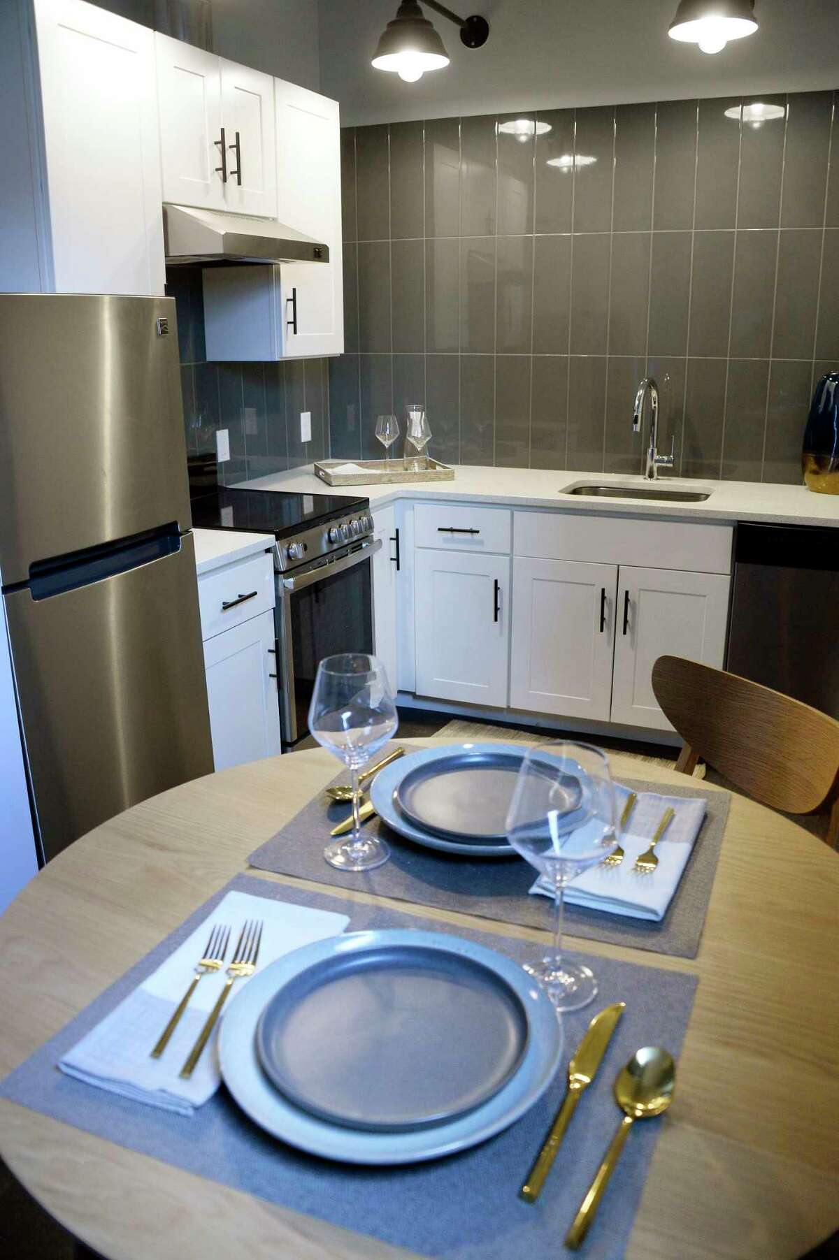 Dinette and kitchen in a model studio apartment at the @HudsonPark apartment complex under construction Tuesday Dec. 4, 2018 in Albany, NY. Formerly the site of Long Energy and originally the Hinckel brewery, the three building complex is being converted into 75 new luxury apartments. (John Carl D'Annibale/Times Union)