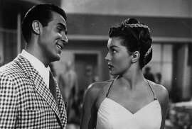 "Ricardo Montalban smiling at Esther Williams in a scene from the film ""Neptune's Daughter,"" 1949. ""Baby It's Cold Outside"" was first popularized in the movie."