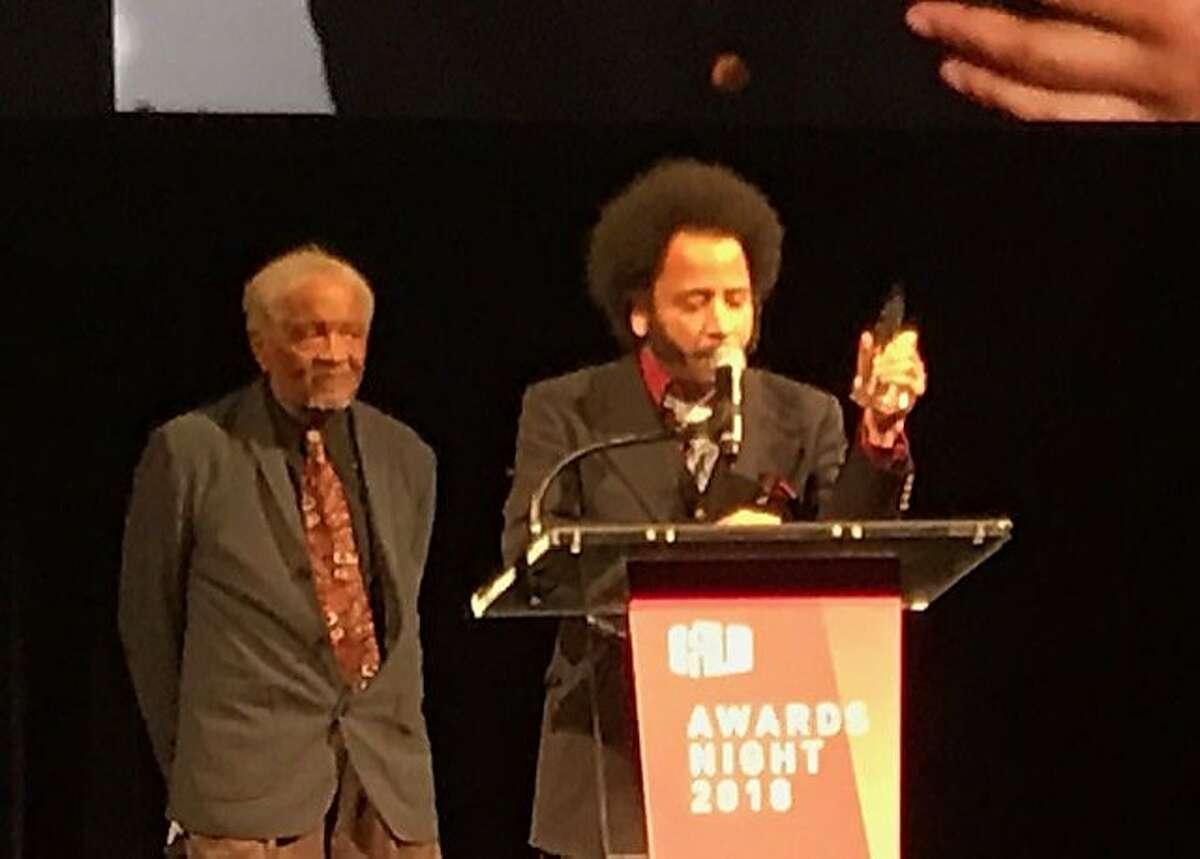 Director Boots Riley accepts award from Ishmael Reed at SFFilm Gala