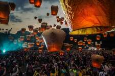 Taiwan illuminated  Tourists release sky lantern during the Pingxi lantern festival on March 2, 2018 in Pingxi, Taiwan. Pingxi, a Taiwanese district known for its old train tracks and lantern launchings, hosts the Pingxi Sky Lantern Festival annually to celebrate the last day of the Lunar New Year by releasing thousands of lanterns which each carrying its flame into the night. The former coal-mining town is lined with workshops which helps visitors build lanterns with paper and glue but critics have said the event is has become unsustainable and angered the locals as up to 600,000 half-burnt lanterns crashes back to earth into surrounding mountains. Sky lanterns were invented in ancient China between AD 220-265 by military strategist Zhuge Liang to transmit information and first introduced in Taiwan in the 19th century. They were originally released as prayers for the coming year at the beginning of the spring planting season but currently only allowed by the government to release of sky lanterns at the rural district in New Taipei.