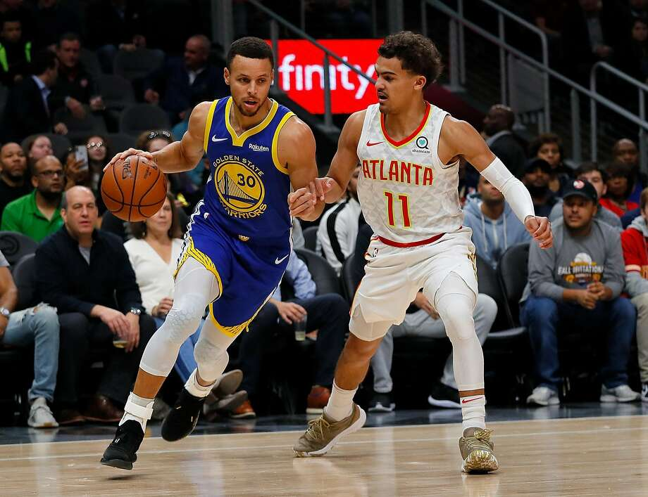 ATLANTA, GA - DECEMBER 03:  Stephen Curry #30 of the Golden State Warriors drives against Trae Young #11 of the Atlanta Hawks at State Farm Arena on December 3, 2018 in Atlanta, Georgia.  NOTE TO USER: User expressly acknowledges and agrees that, by downloading and or using this photograph, User is consenting to the terms and conditions of the Getty Images License Agreement.  (Photo by Kevin C. Cox/Getty Images) Photo: Kevin C. Cox, Getty Images