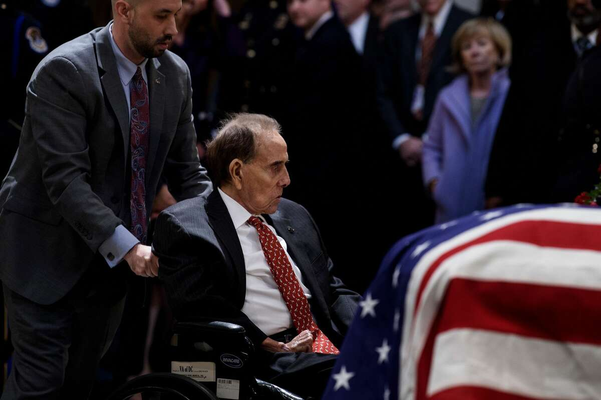 Former US Senator Bob Dole and others pay their respects as the remains of former US President George H. W. Bush lie in state in the US Capitol's rotunda December 4, 2018 in Washington, DC.