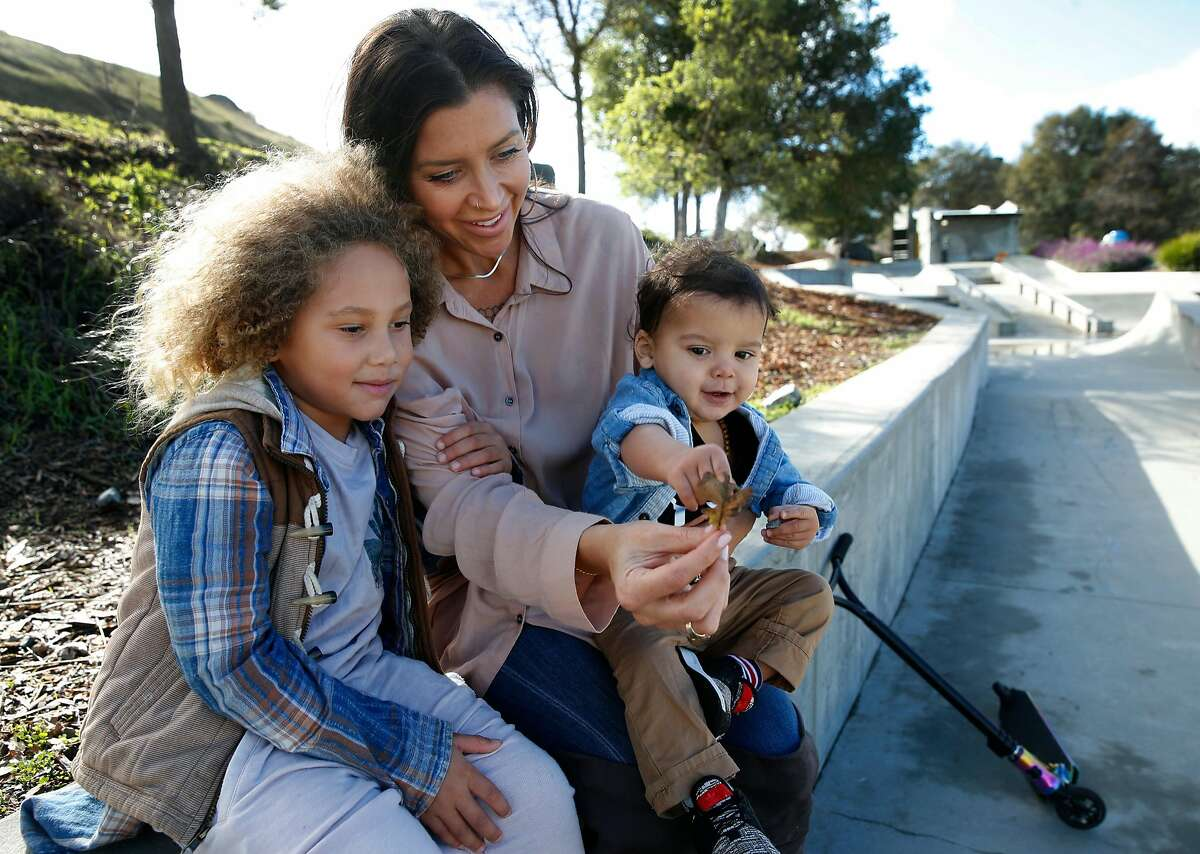 Kelli Peterson is seen with her two sons Kin, 5, and Che, 1, at a skatepark in San Rafael, Calif. on Saturday, Dec. 1, 2018.