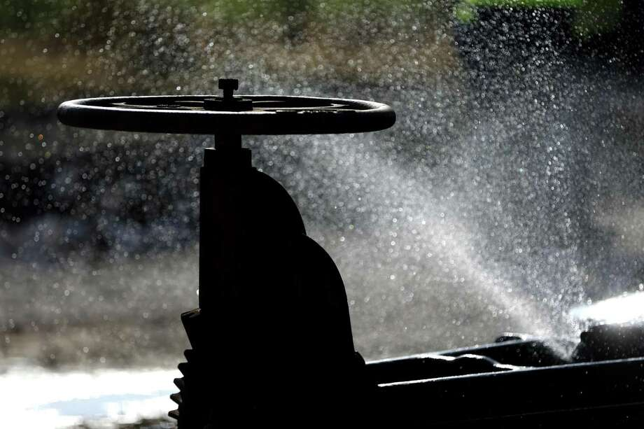 Water sprays Tuesday, Dec. 4, 2018 from the Pucek Catfish Farm well in south Bexar County. The catfish farm was embroiled in a years-long water rights case before shutting down. SAWS is in the process of capping the well since it is no longer used. Photo: William Luther, Staff / San Antonio Express-News / © 2018 San Antonio Express-News