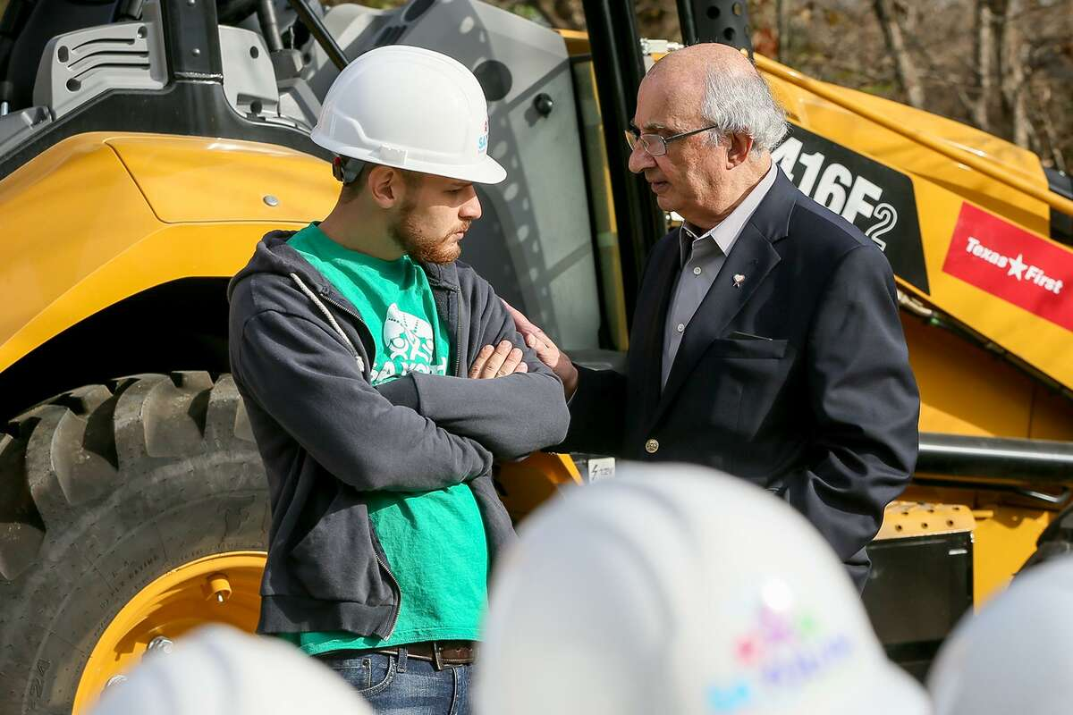 Local philanthropist Harvey Najim (right) talks with Youthbuild student Johnrene Vasquez, 21, at the groundbreaking on the East Side for the fifth house to be built by students in SA Youth's YouthBuild program on Tuesday, Dec. 3, 2018. Students learn construction skills under a training program that gives high-risk youth an opportunity to continue their education.