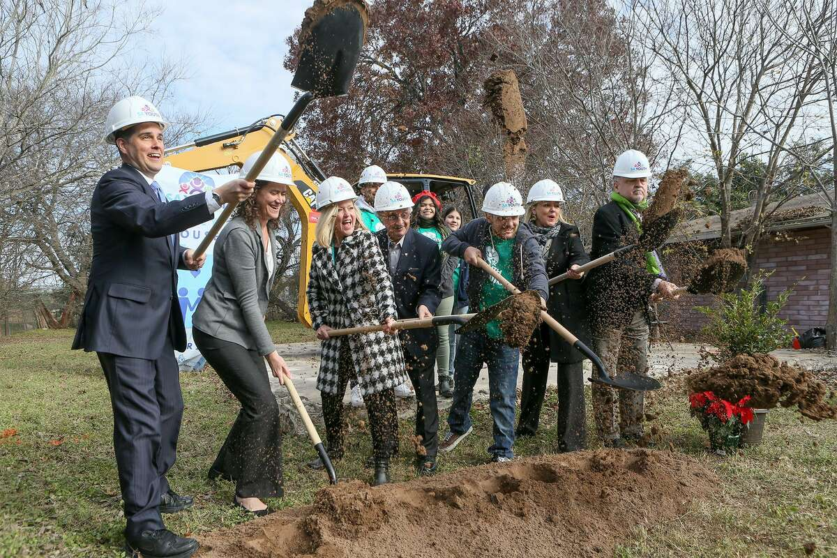 Michael Mewborne (from left), Katherine Tapley, Asia Ciaravino, local philanthropist Harvey Najim, Johnrene Vasquez, Michelle Hutchinson and John Speegle shovel dirt at the groundbreaking on the East Side for the fifth house to be built by students in SA Youth's YouthBuild program on Tuesday, Dec. 3, 2018. Students learn construction skills under a training program that gives high-risk youth an opportunity to continue their education.