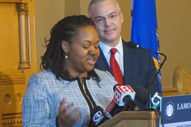 Newly-opointed secretary of the Office of Policy and Management Melissa McCaw, speaks during a press conference Tuesday at the Capitol building in Hartford.