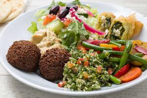 The Houston region's two Noon Mediterranean restaurants will change to Daphne's Mediterranean name next year. Daphne's vegetarian plate is pictured.