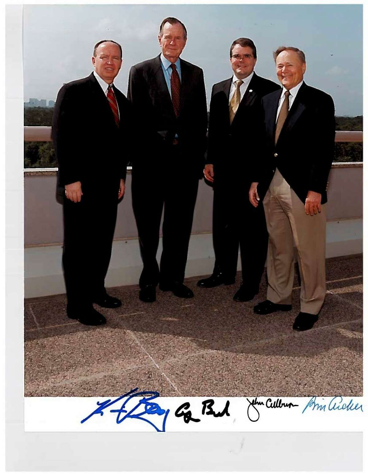 Former President George H.W. Bush poses in 2000 with Rep. Kevin Brady, R-The Woodlands. Also pictured are Congressman John Culberson and to the right of Culberson is former Ways & Means Chairman and Texas Congressman Bill Archer.