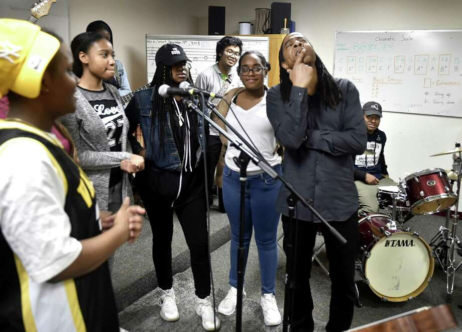 Doug Wimbish, bassist of the rock band Living Colour, right, visits with High School in the Community in New Haven Tuesday. Photo: Peter Hvizdak / Hearst Connecticut Media / New Haven Register