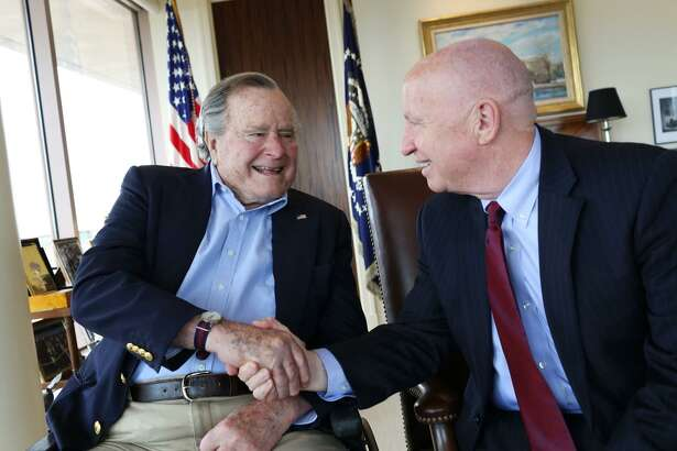 Former President George H.W. Bush is shown in this photograph with U.S. Rep. Kevin Brady, R-The Woodlands, as the two share a moment. Brady talked with reporters on Tuesday, Dec. 4, about Bush's legacy and the relationship the two Texas politicians shared.