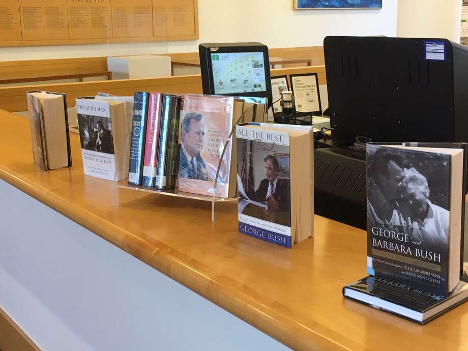 Books about the life of President George H.W. Bush are on display at the Greenwich Public Library Photo: / Robert Marchant / Hearst Media