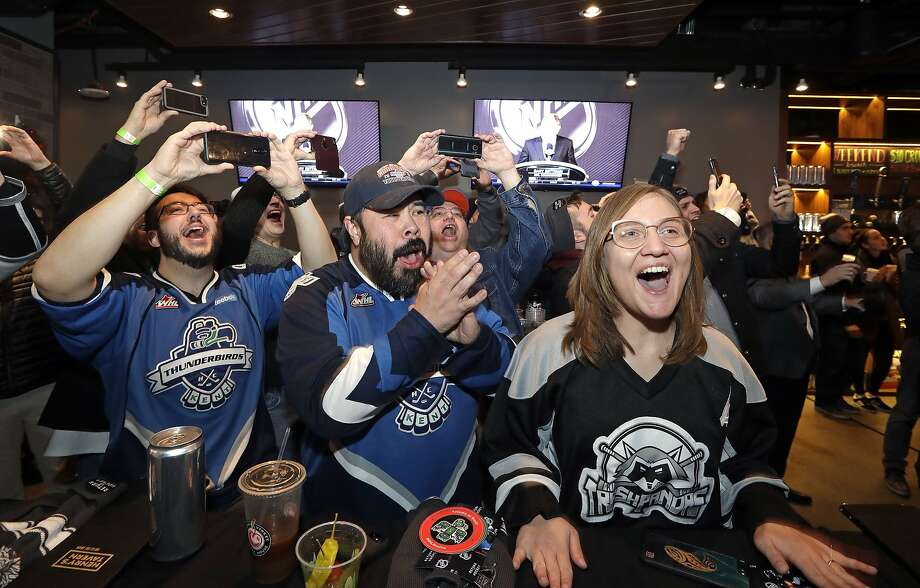 Ryan Kelly, left, Otto Rogers and Rebecca Moloney cheer the announcement of a new NHL hockey team in Seattle at a celebratory party Tuesday, Dec. 4, 2018, in Seattle. The NHL Board of Governors unanimously approved adding Seattle as the league's 32nd franchise on Tuesday, with play set to begin in 2021 to allow enough time for arena renovations. (AP Photo/Elaine Thompson) Photo: Elaine Thompson, Associated Press
