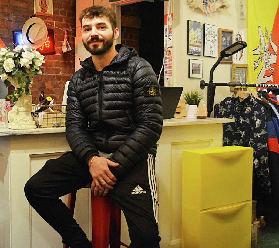 "Middletown's First Twelve urban clothing boutique in Main Street Market is run by Middletown High School and Central Connecticut State University graduate Dillon Milardo, 25, who began the business venture with the help of his college roommate Dave Ambrose. The company is rooted in their college days, when Milardo took every item out of his dorm room closet and filled it with First Twelve merchandise, creating a ""pop-up"" shop where his classmates could buy items on the spot. Photo: Cassandra Day / Hearst Connecticut Media"