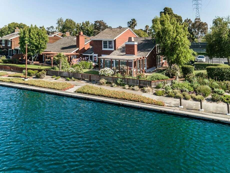 A waterfront property at 845 Grenada Ln. in Foster City offers resort-style living close to San Francisco. Photo: Dennis Mayer