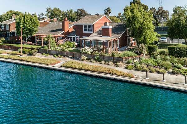 A waterfront property at845 Grenada Ln. in Foster City offers resort-style living close to San Francisco.