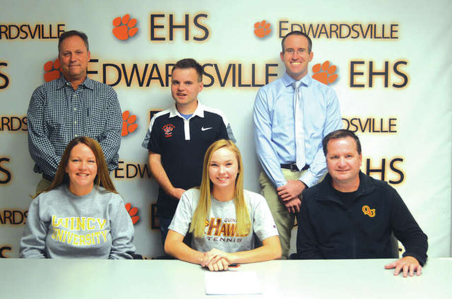 Edwardsvllle senior Annie McGinnis will play tennis at Quincy University. In the front row, from left to right, are mother Sharla McGinnis, Annie McGinnis and father Kevin McGinnis. In the back row, from left to right, are EHS head coach Dave Lipe, brother Mitch McGinnis and EHS assistant coach Kirk Schlueter. Photo: Scott Marion/Intelligencer