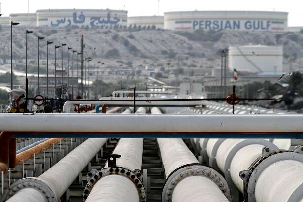 (FILES) In this file photo taken on February 23, 2016 A picture shows export oil pipelines at an oil facility in the Khark Island, on the shore of the Gulf, on February 23, 2016. - OPEC members and other oil-producing countries convene in Vienna this week December 2018 to discuss cutting their output targets, torn between plunging oil prices and pressure from the United States to keep prices low. Under the watchful eye of major producers such as Saudia Arabia and Russia, delegates from both the Organization of Petroleum Exporting Countries and around 10 other non-OPEC members -- which together account for more than half of total global output -- will first hold preparatory meetings earlier in the week and then full plenary sessions on Thursday and Friday. (Photo by - / AFP)-/AFP/Getty Images