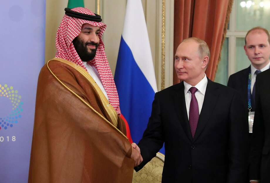 (FILES) In this file photo taken on December 01, 2018 Saudi Arabia's Crown Prince Mohammed bin Salman (L) and Russia's President Vladimir Putin shake hands during a bilateral meeting on the second day of the G20 Leaders' Summit in Buenos Aires, on December 01, 2018. Photo: Mikhail Klimentyev, AFP/Getty Images
