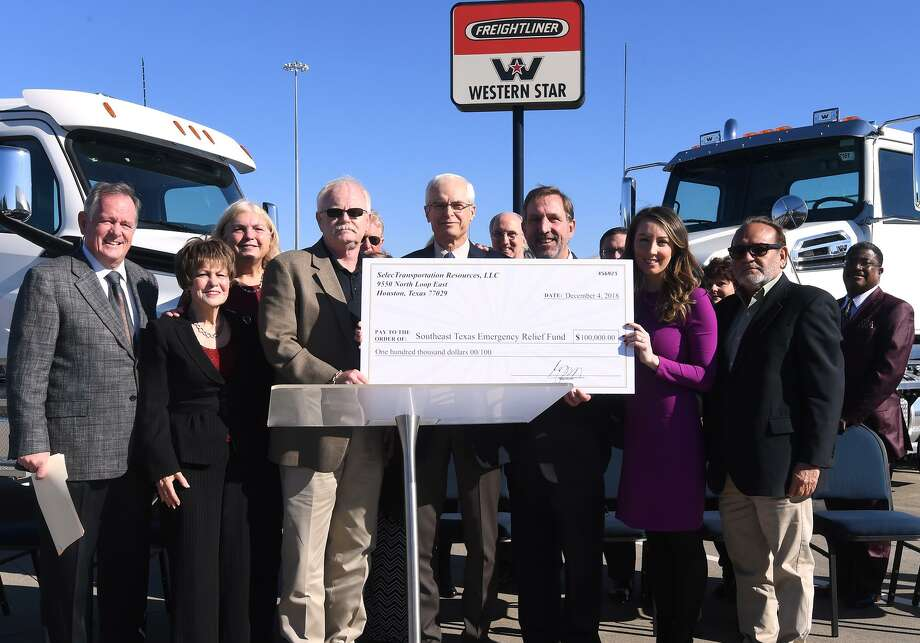The Beaumont Freightliner dealership donated Tuesday a check for $100,000 to the Southeast Texas Emergency Relief Fund. The funds will be used to assist with Tropical Storm Harvey repairs.   Photo taken Tuesday, 12/4/18 Photo: Guiseppe Barranco/The Enterprise, Photo Editor / Guiseppe Barranco ©
