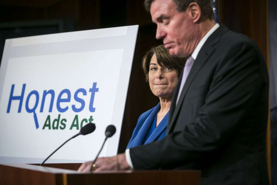 Sens. Mark Warner (D-Va.) and Amy Klobuchar (D-Minn.), who sponsored legislation to compel Facebook and other internet firms to disclose who bought political ads on their sites, on Capitol Hill Oct. 19, 2017. Arguably, corporate America after WWII cared more for the country than today's CEOs. Photo: AL DRAGO /NYT / NYTNS