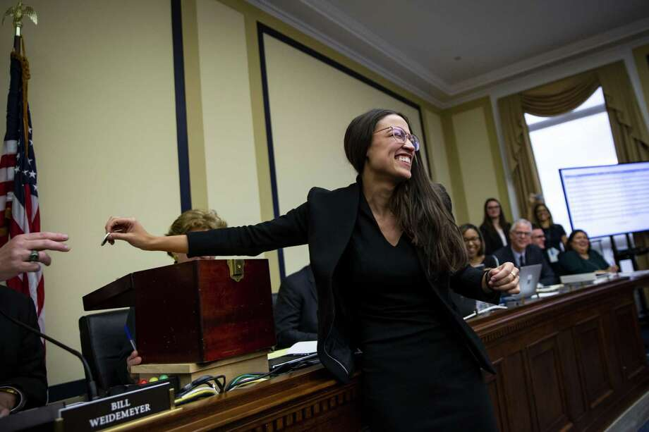 Representative-elect Alexandria Ocasio-Cortez, a Democrat from New York, draws a number during the member-elect room lottery on Capitol Hill on Nov. 30. The freshman has already shaken up many. Photo: Al Drago /Bloomberg / © 2018 Bloomberg Finance LP