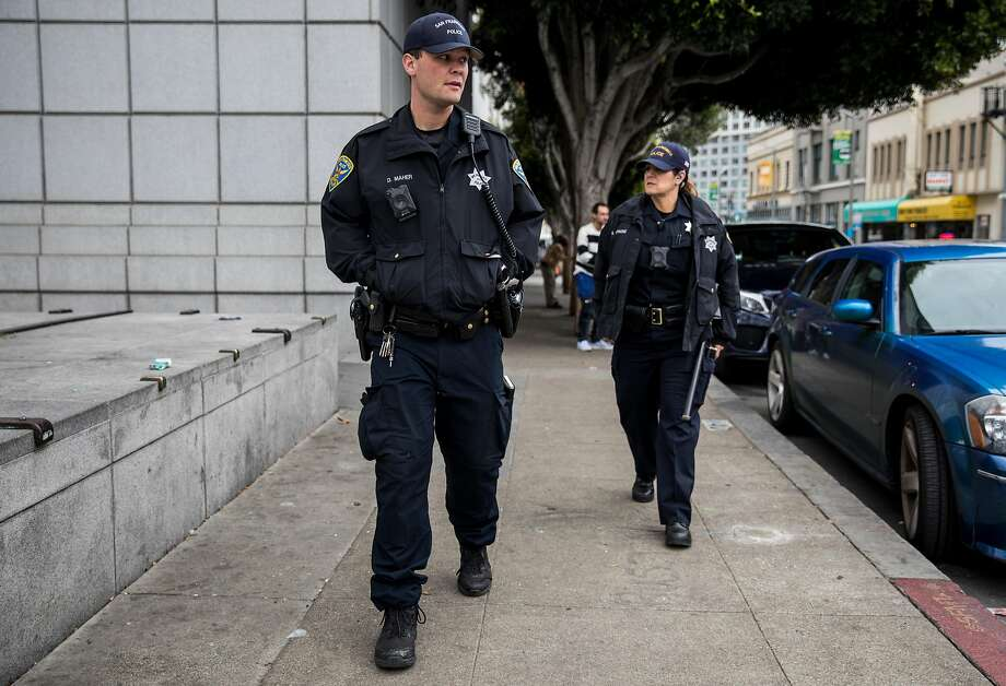 SFPD Officer Maher (left) and Officer Richmond patrol Grove Street near the Civic Center Plaza area in San Francisco, Calif. on Tuesday, Dec. 4, 2018. Photo: Jessica Christian / The Chronicle