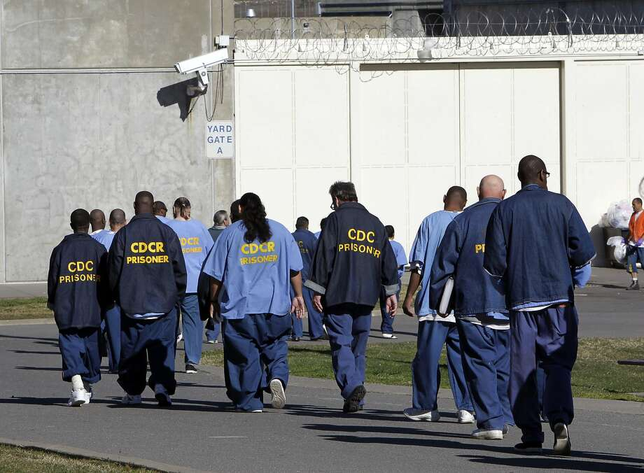 FILE - In this Feb. 26, 2013, file photo, inmates walk through the exercise yard at California State Prison Sacramento, near Folsom, Calif. California arrest rates have dropped nearly 60 percent since 1989, yet blacks are three times more likely to be arrested than whites, according to a report released by the Public Institute of California, Monday Dec. 3, 2018. (AP Photo/Rich Pedroncelli, File) Photo: Rich Pedroncelli / Associated Press