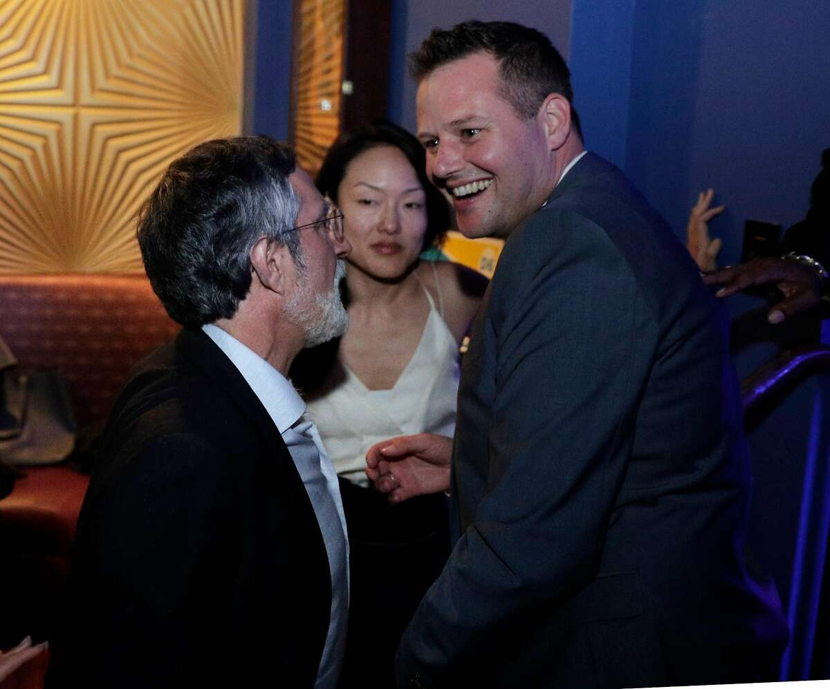Supervisor District 6 candidate Matt Haney chats with Supervisor Aaron Peskin, and former Supervisor Jane Kim at an election watch party for the District 6 Supervisor candidate in San Francisco, Calif., on Tuesday, November 6, 2018.