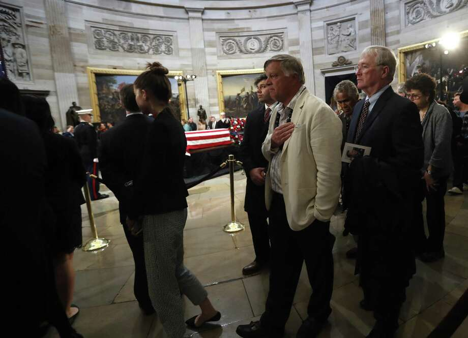 Visitors file past the casket of President George H.W. Bush as he laid in state at the United States Capitol Rotunda, Tuesday, Dec. 4, 2018, in Washington. Bush will lie in state in the Rotunda until Wednesday morning. Photo: Karen Warren, Houston Chronicle / Staff Photographer / © 2018 Houston Chronicle