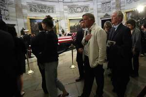 Visitors file past the casket of President George H.W. Bush as he laid in state at the United States Capitol Rotunda, Tuesday, Dec. 4, 2018, in Washington. Bush will lie in state in the Rotunda until Wednesday morning.