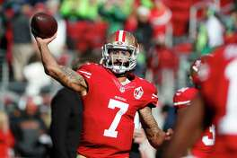 """FILE - In this Jan. 1, 2017 file photo, San Francisco 49ers quarterback Colin Kaepernick (7) warms up before an NFL football game against the Seattle Seahawks in Santa Clara, Calif. Washington Redskins coach Jay Gruden says the team """"talked about and discussed"""" bringing in Kaepernick for a tryout """"but we will probably go in a different direction."""" Gruden told reporters during a conference call Tuesday, Dec. 4, 2018 that would there have been """"a greater possibility"""" of considering Kaepernick if the Redskins were in need of a QB in Week 1 rather than at this stage of the season now."""