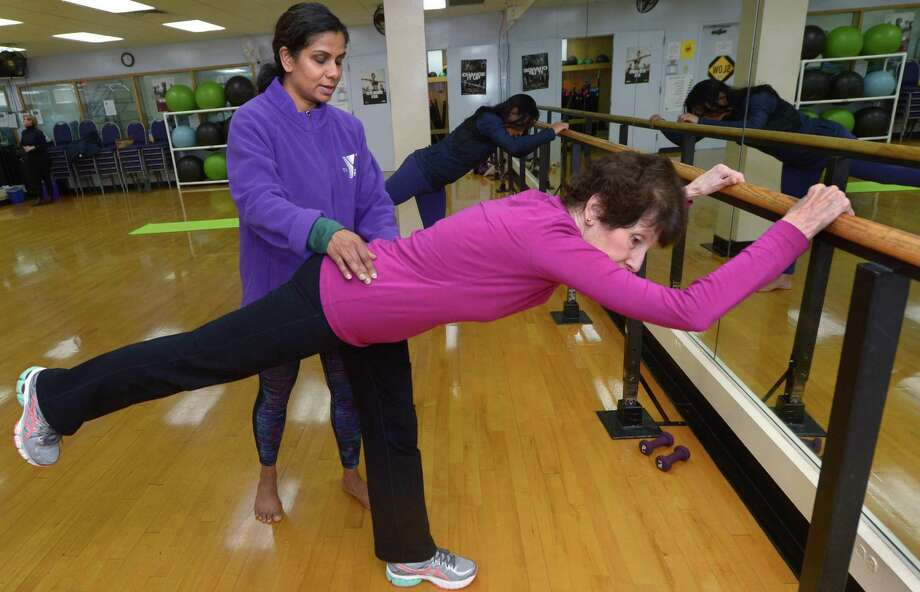 Instructor and Trainer Suma Iyer instructs Wilton residents Fran Schmale during a Barre Class at the Riverbrook Regional Tuesday, December 4, 2018, in Wilton, Conn. The city of Norwalk has received a proposal from Riverbook Regional YMCA to operate the South Norwalk Community Center at 98 South Main St. Photo: Erik Trautmann / Hearst Connecticut Media / Norwalk Hour