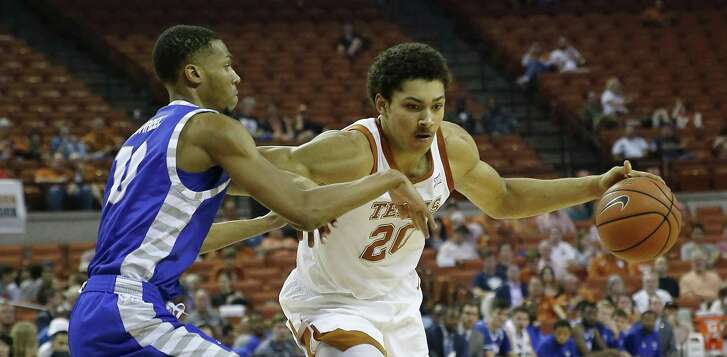 AUSTIN, TX - NOVEMBER 6: Jericho Sims #20 of the Texas Longhorns drives around Cam Burrell #10 of the Eastern Illinois Panthers at the Frank Erwin Center on November 6, 2018 in Austin, Texas. (Photo by Chris Covatta/Getty Images)
