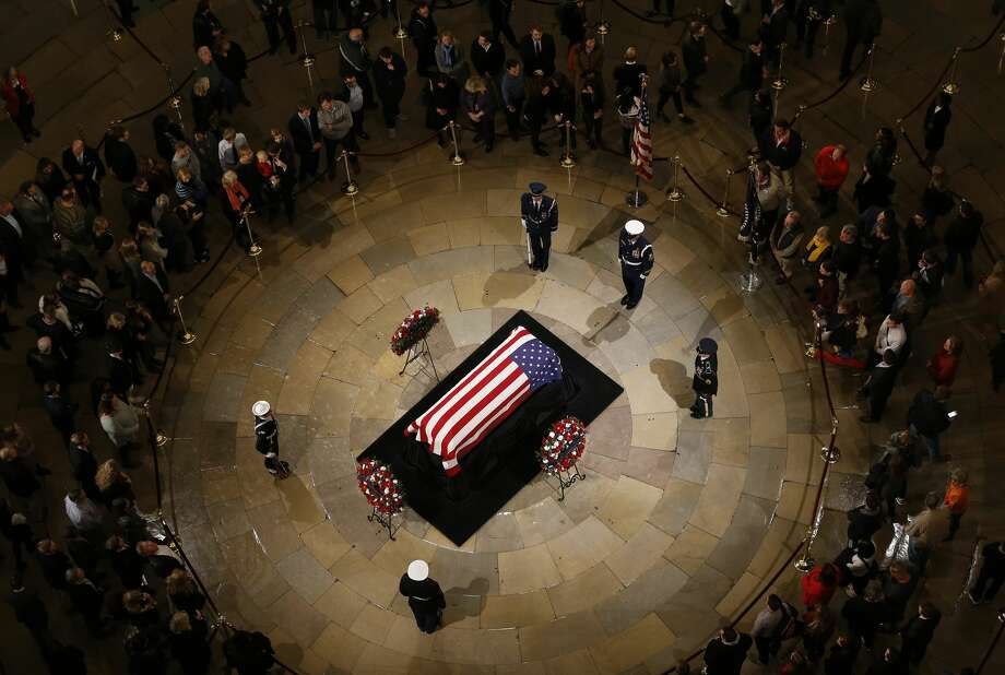 The public files around the casket as President George H.W. Bush laid in state at the United States Capitol Rotunda, Monday, Dec. 3, 2018, in Washington. Bush will lie in state in the Rotunda until Wednesday morning. Photo: Karen Warren/Staff Photographer