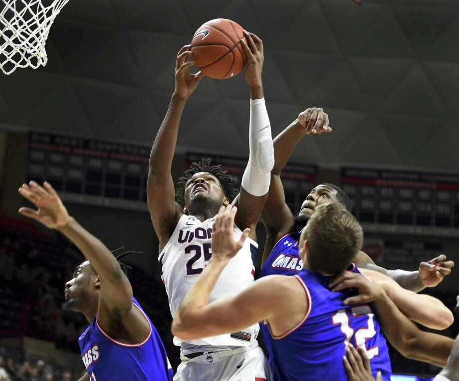 UConn's Josh Carlton (25) pulls down a rebound against UMass-Lowell on Nov. 27 in Storrs. Photo: Stephen Dunn / Associated Press / Copyright 2018 The Associated Press. All rights reserved