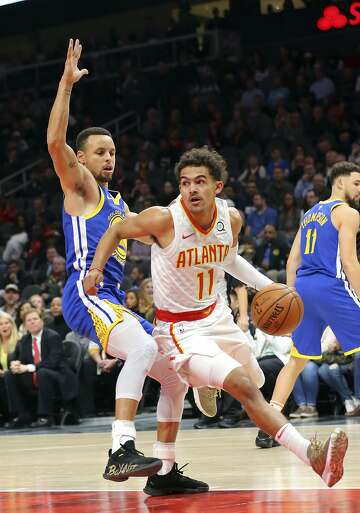 199a15662411 3of3Atlanta Hawks guard Trae Young (11) drives against Golden State Warriors  guard Stephen Curry (30) during the first half of an NBA basketball game  Monday ...