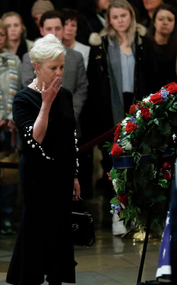 Cindy McCain, wife of John McCain places a kiss on a wreath as she paused near the casket of President George H.W. Bush while he laid in state at the United States Capitol Rotunda, Tuesday, Dec. 4, 2018, in Washington. Bush will lie in state in the Rotunda until Wednesday morning. Photo: Karen Warren, Staff Photographer / © 2018 Houston Chronicle