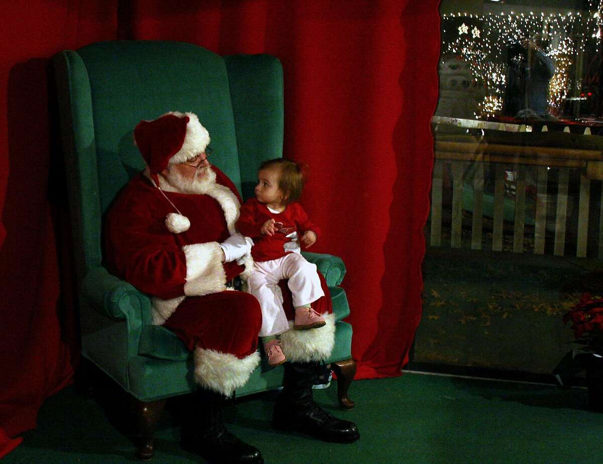 **FOR USE WITH AP LIFESTYLES** Madison Borselli, 17-month-old, sits on the lap of Dan Dowling, dressed as Santa Claus, at the Stone Zoo in Stoneham, Mass., Thursday, Nov. 29, 2007. (AP Photo/Hillary Rhodes)