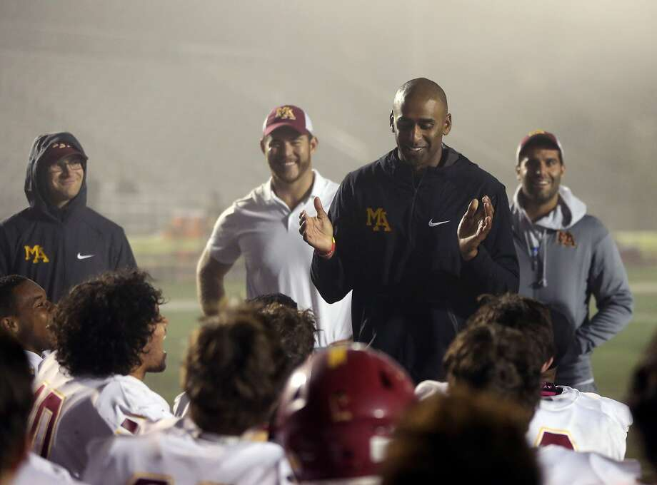 Menlo-Atherton coach Adhir Ravipati enjoys a light-hearted moment with his team that will have to travel 300 miles. Photo: Darren Yamashita / MaxPreps