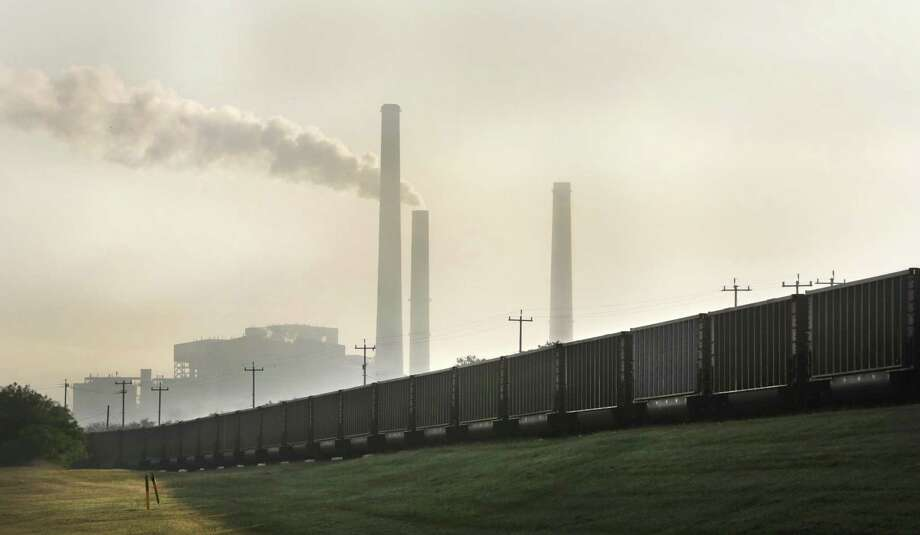 A train full of coal on the tracks that lead to the CPS Power Plants at Calaveras Lake, April 25, 2018. The Deely plant will be shut down. A reader wants to know how much cleaner the city's air is. Photo: Bob Owen /San Antonio Express-News / ©2018 San Antonio Express-News