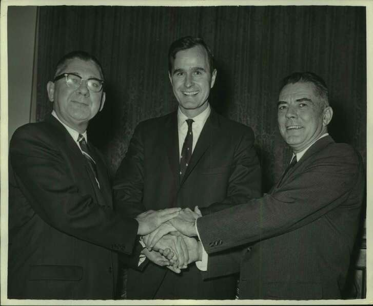 Congressman George H. W. Bush of Harris County's 7th District is congratulated on his appointment to the House Ways & Means Committee by (left) Congressman Wilbur D. Mills (Democrat from Arkansas), Committee chairman, and (right) Congressman John W. Byrnes (Republican from Wisconsin), ranking Minority member of the Committee. Bush, one of two Texas Republicans elected to the house last fall, is the only Texan now on the Ways & Means Committee. Sr.