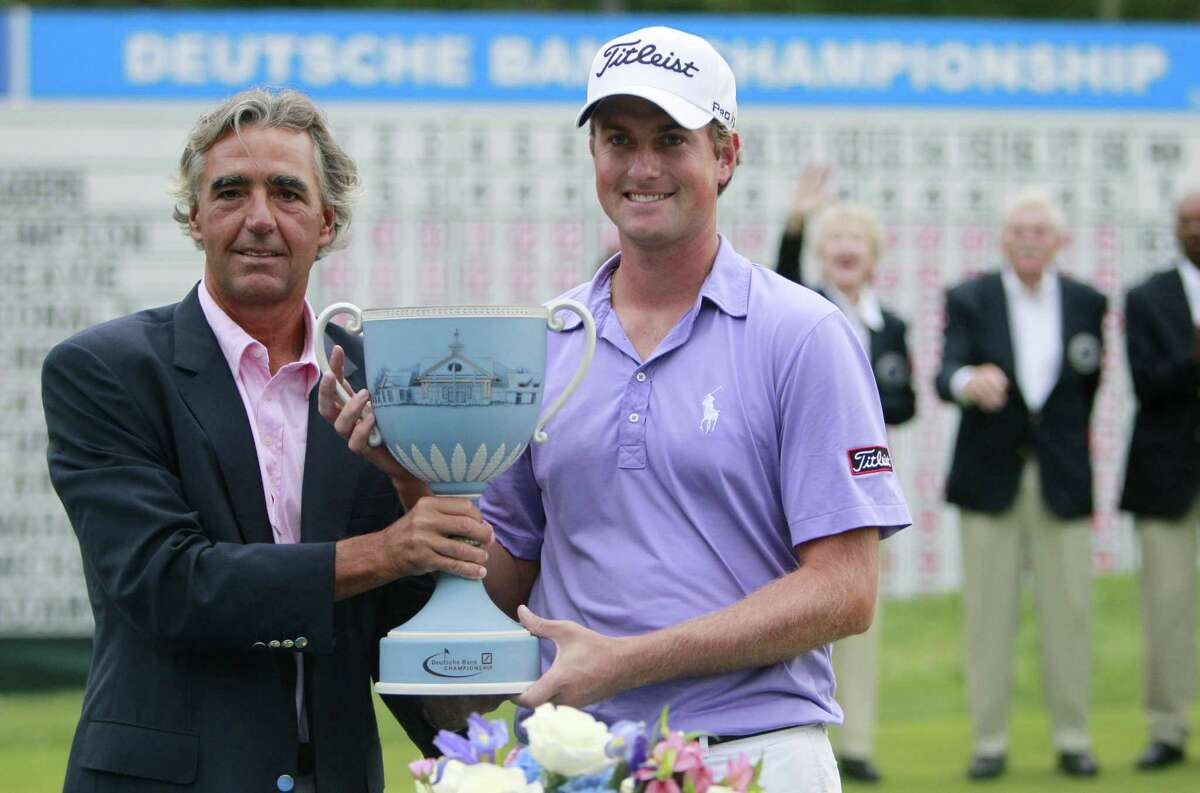 FILE - In this Sept. 5, 2011, file photo, Webb Simpson, right, and CEO of Deutsche Bank Americas Seth Waugh pose with the trophy after the final round of the Deutsche Bank Championship golf tournament at TPC Boston in Norton, Mass. Waugh was appointed Tuesday, Aug. 28, 2018, as chief executive of the PGA of America. (AP Photo/Michael Dwyer, File)