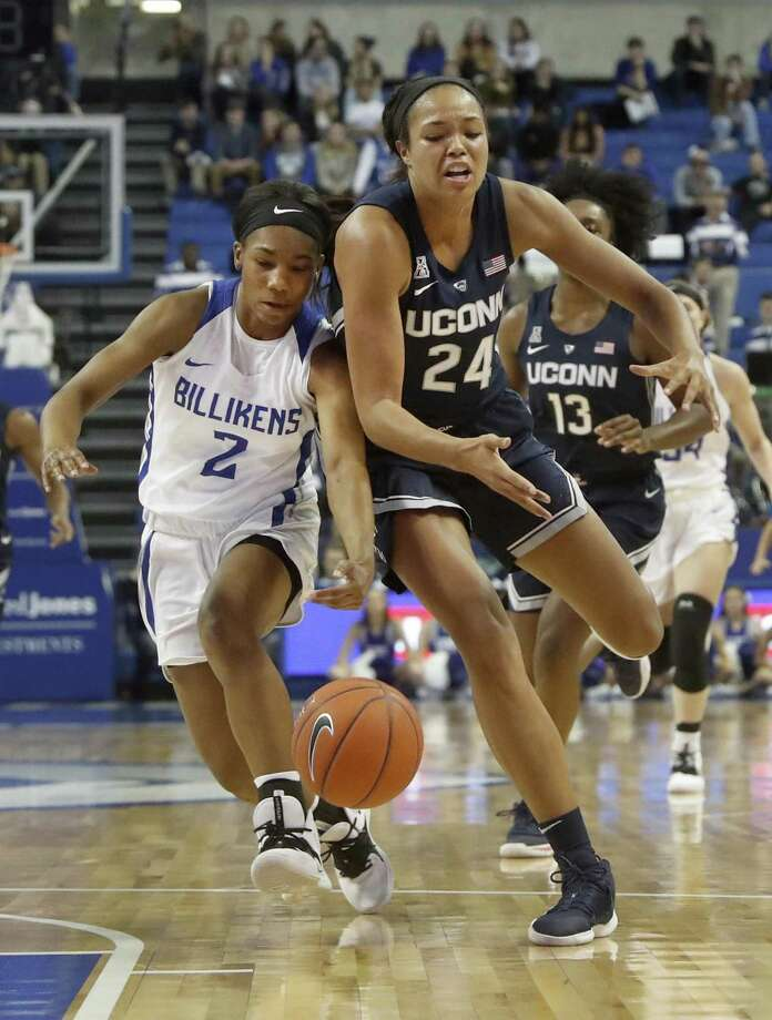 UConn's Napheesa Collier (24) and Saint Louis' Ciaja Harbison (2) collide as they chase after a loose ball on Tuesday in St. Louis. Photo: Jeff Roberson / Associated Press / Copyright 2018 The Associated Press. All rights reserved.
