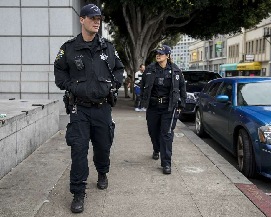 Police Officers Maher (left) and Richmond patrol Grove Street near the Civic Center Plaza area in S.F.'s gritty Tenderloin. Photo: Jessica Christian / The Chronicle / ONLINE_YES