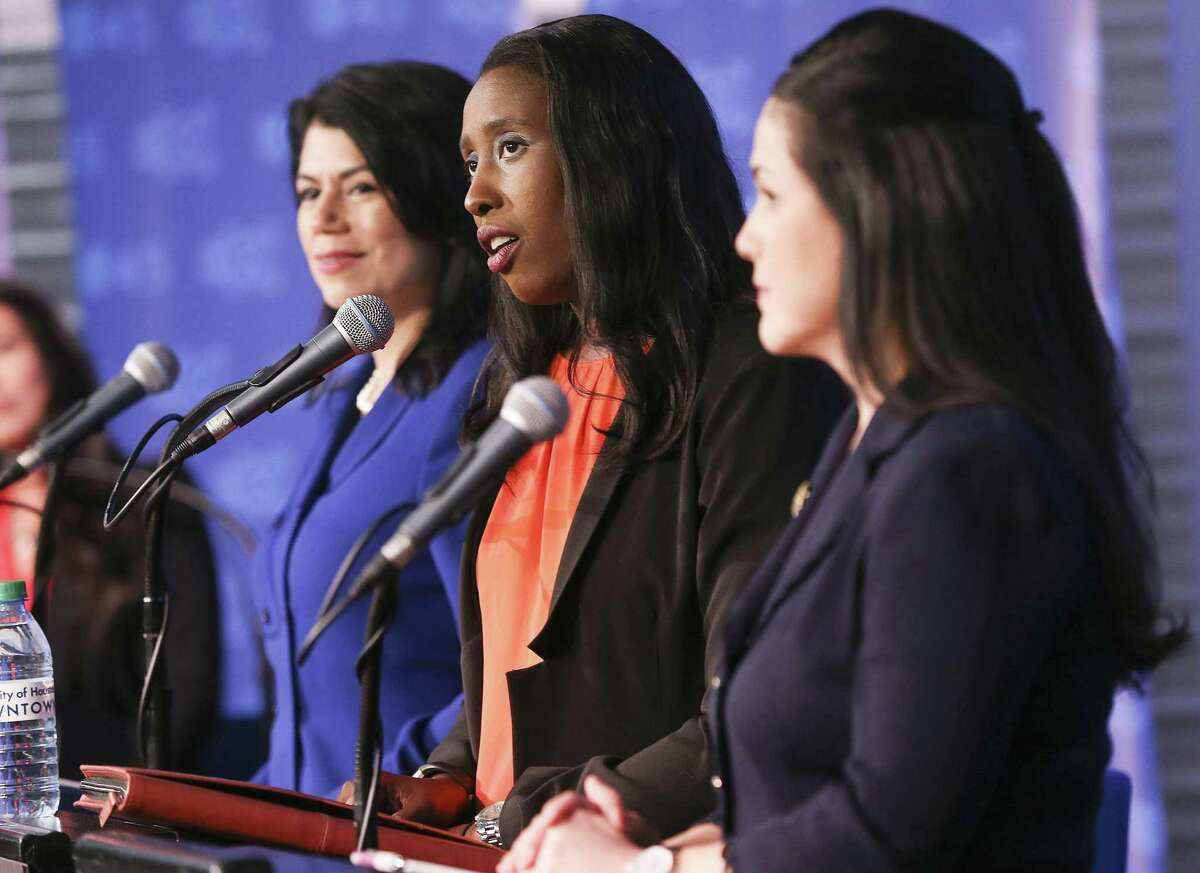 Mia Mundy, center, answers questions during a debate against other the democratic candidates, State Rep. Carol Alvarado, left, and State Rep. Ana Hernandez, for the special election for Texas Senate Dist. 6 at University of Houston Downtown on Tuesday, Dec. 4, 2018 in Houston.